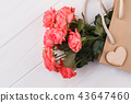 Pink roses in shopping bag. 43647460