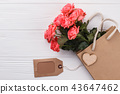 Bouquet of pink roses, shopping bag and label. 43647462