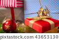 Beautiful image for winter holidays and celebrations. Gift boxes, glowing lights and Christmas 43653130