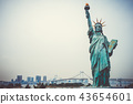Statue of liberty and tokyo cityscape, Japan 43654601
