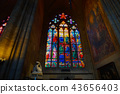 Inside st. Vitus. Cathedral and stained glass with Catholic icons. 43656403