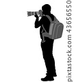 photographer with his telephoto lens silhouette 43656550