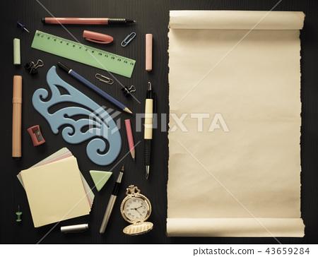 school supplies on black wood 43659284