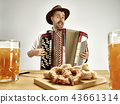 Man in traditional bavarian clothes playing accordion. Oktoberfest 43661314