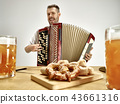 Man in traditional bavarian clothes playing accordion. Oktoberfest 43661316