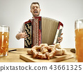 Man in traditional bavarian clothes playing accordion. Oktoberfest 43661325