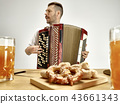 Man in traditional bavarian clothes playing accordion. Oktoberfest 43661343
