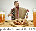 Man in traditional bavarian clothes playing accordion. Oktoberfest 43661378