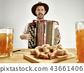 Man in traditional bavarian clothes playing accordion. Oktoberfest 43661406