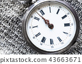 retro pocket watch on silver cloth close up 43663671