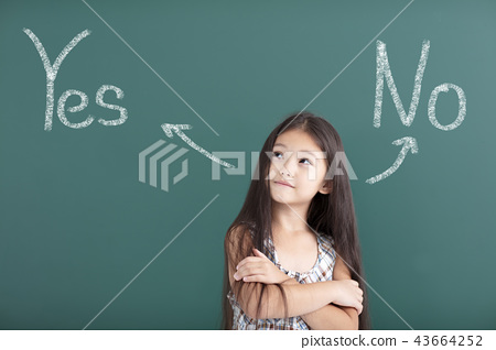 beautiful little girl thinking before chalkboard 43664252