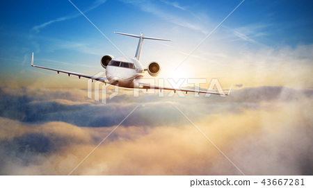 Luxury private jetliner flying above clouds 43667281