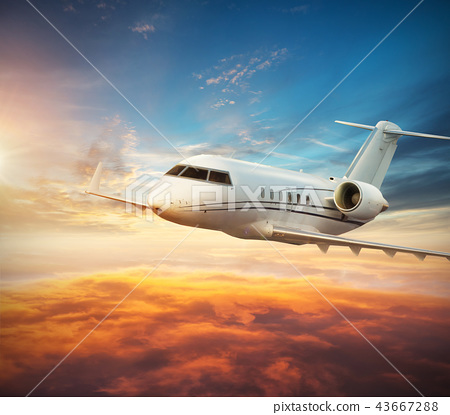 Luxury private jetliner flying above clouds 43667288