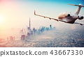 Private jet plane flying above Dubai city 43667330