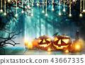 Spooky halloween pumpkins on wooden planks 43667335