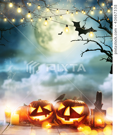 Spooky halloween pumpkins on wooden planks 43667338