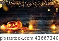 Spooky halloween pumpkins on wooden planks 43667340