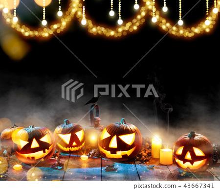 Spooky halloween pumpkins on wooden planks 43667341