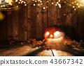 Spooky halloween pumpkin on wooden planks 43667342
