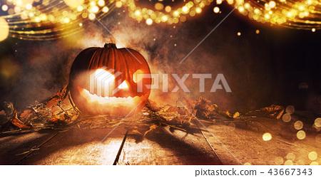 Spooky halloween pumpkin on wooden planks 43667343