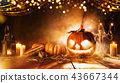 Spooky halloween pumpkin on wooden planks 43667344