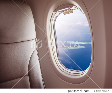 Airplane window with Maldives island view 43667682