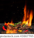 Beef steaks being grilled, isolated on black 43667765
