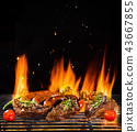 Various meat being grilled, isolated on black 43667855