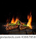 Beef steaks being grilled, isolated on black 43667858