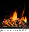Various chicken meat being grilled 43667862