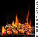 Various meat being grilled, isolated on black 43667867
