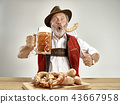 Germany, Bavaria, Upper Bavaria, man with beer dressed in traditional Austrian or Bavarian costume 43667958