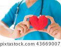 Doctor hands holding red heart. 43669007
