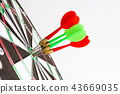 Green and red darts arrows in the target center 43669035
