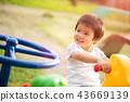 Happy little girl having fun on a playground 43669139