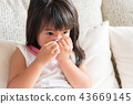 Sick little Asian girl wiping or cleaning nose 43669145