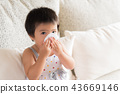 Sick little Asian girl wiping or cleaning nose 43669146
