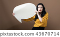 Young woman holding a speech bubble 43670714