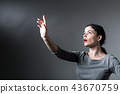 Young woman pointing at something 43670759