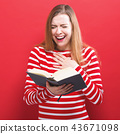 Young woman with a book 43671098