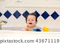 Baby boy taking a bath 43671119