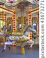 Old fashioned french carousel with horses 43673271