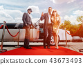 Couple arriving with limousine walking red carpet 43673493
