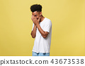 African american man with beard smiling having shy look peeking through fingers, covering face with 43673538
