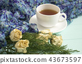 Cup of tea with dried roses and branches of junipe 43673597