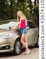 Cute girl with paper cup near car 43674110