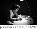 Monochrome portrait Asian girl doing homework 43679290
