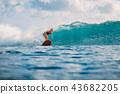 Surf woman ride on surfboard. Woman in ocean 43682205