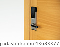 Hotel electronic lock on wooden door 43683377