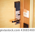 Electronic card smart lock on wooden door at the hotel for power. 43683460